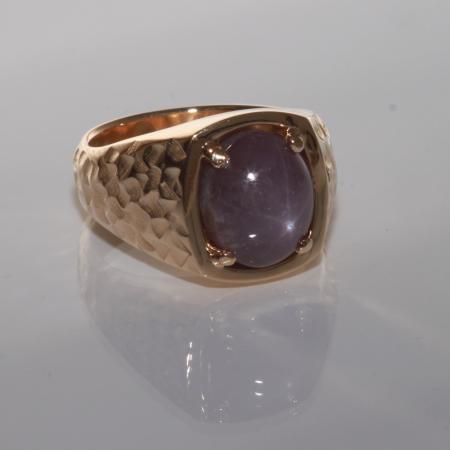 Custom purple star sapphire ring