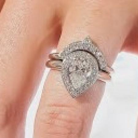 Pear shape halo diamond ring with tiara style band