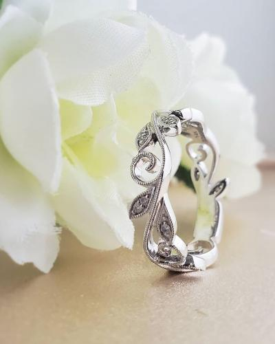 Floral scroll diamond band