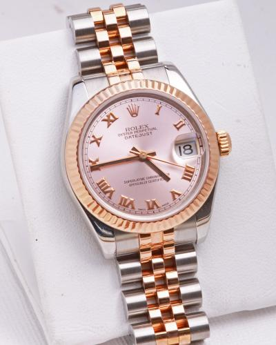 Ladies rolex rose and stainless
